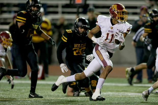 Menlo-Atherton's Troy Franklin (11) heads for ...