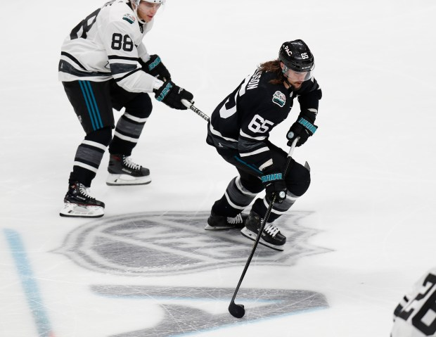 Pacific Division All-Star and Sharks defenseman Erik Karlsson (65) controls  the puck against Central Division All-Star Patrick Kane (88) of the Chicago  ... b5ee3ff0a