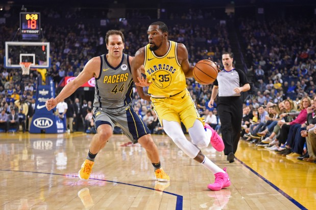 50c1fc539b8 Golden State Warriors  Kevin Durant (35) drives past Indiana Pacers  Bojan  Bogdanovic (44) during the first quarter of their NBA game at Oracle Arena  in ...