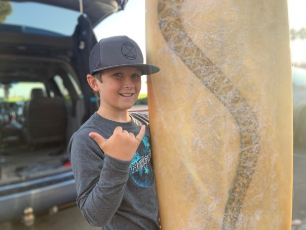 11-year-old California surfer recounts moment he was confronted by whale, a scene captured on viral video