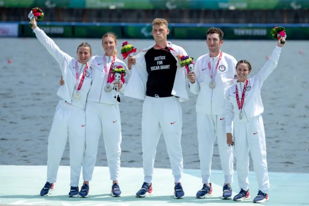 Five U.S. Paralympians celebrate their silver medal win in the PR3 mixed four with coxswain competition