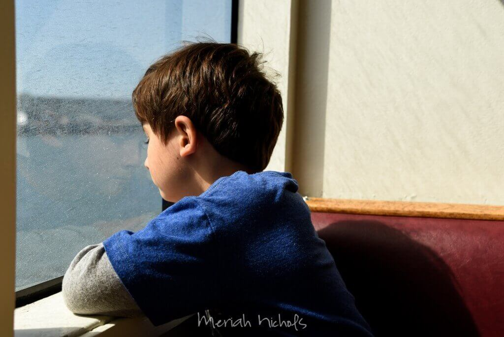 Micah gazes out on the water