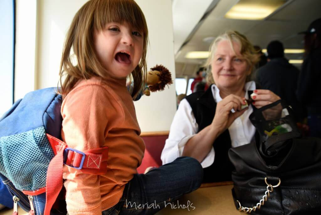 small girl ( Moxie) laughs while a devastatingly attractive older woman (- her Nana) smiles at her