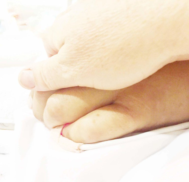 Holding Dana's hand when he was in his coma