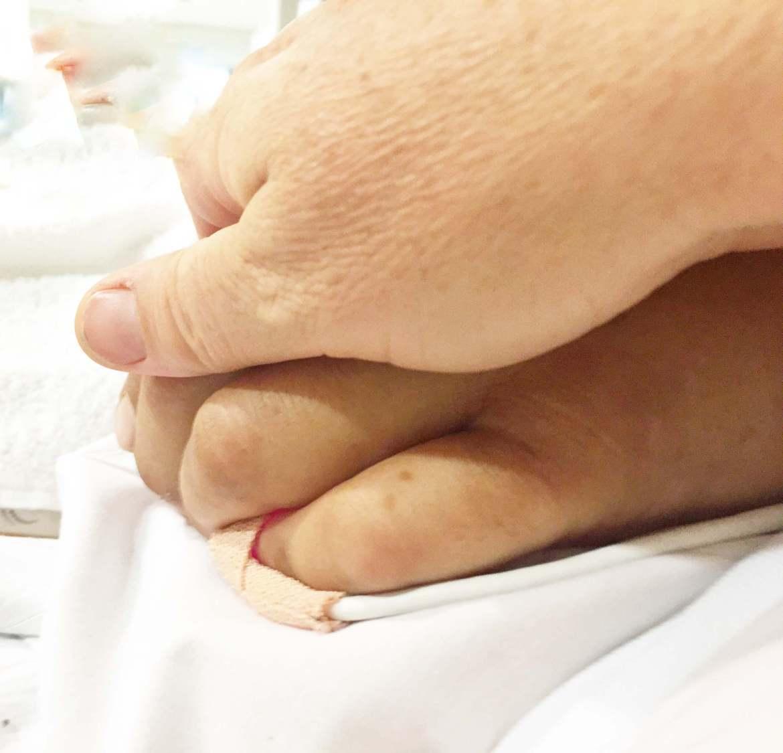 meriah holding dana's hand