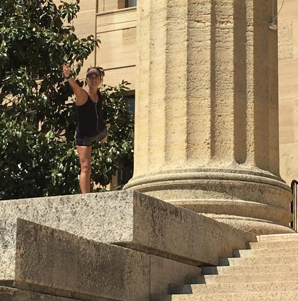 Sandy Ziya demonstrates strength training.