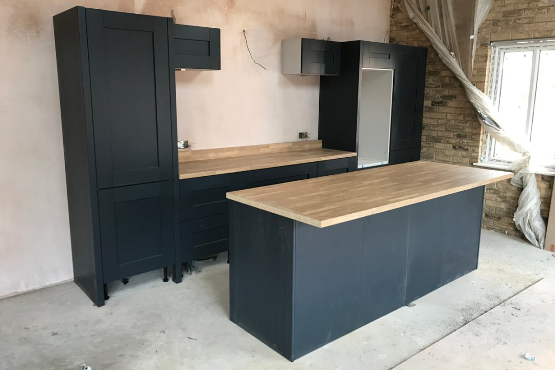 During fitting of a Second Nature Kitchen in Poole. Colour: Charcoal, Brand: Second Nature. Door range: Milbourne
