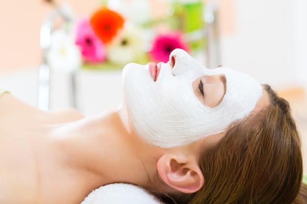 wellness woman receiving facial mask spa clean moist skin 79405 12875