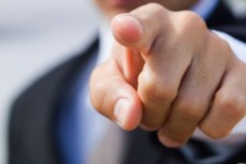 Close-up of a businessman pointing forward