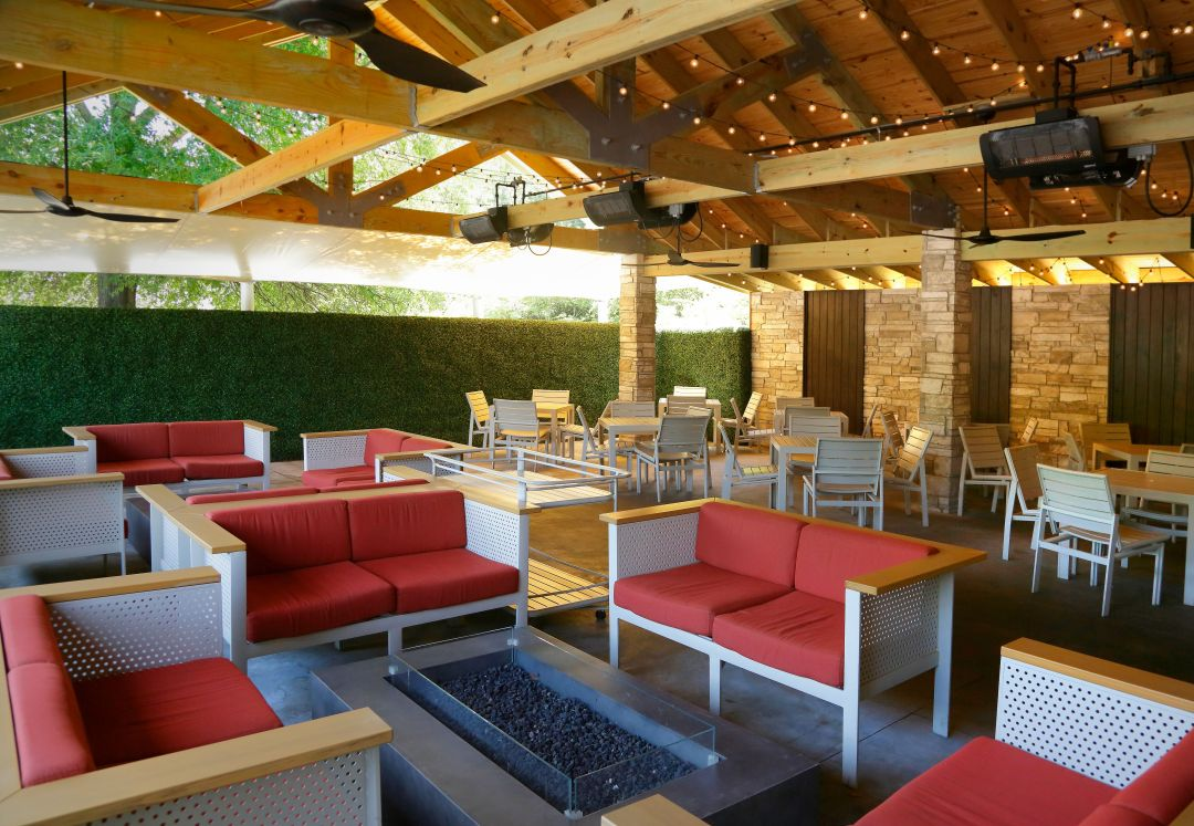 patio with red couches and seating area