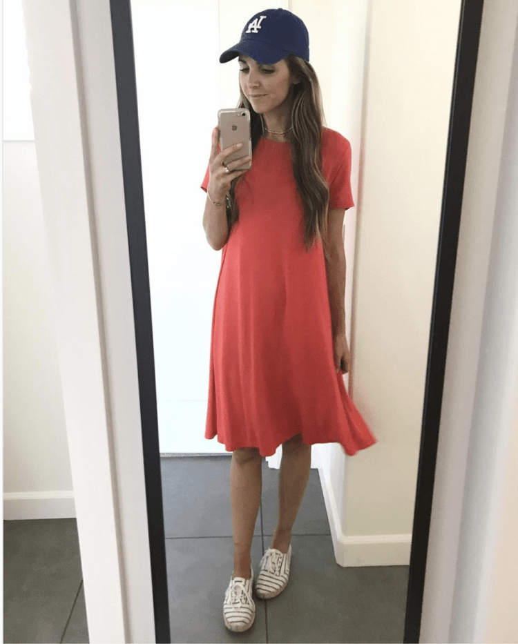 red swing dress with sneakers