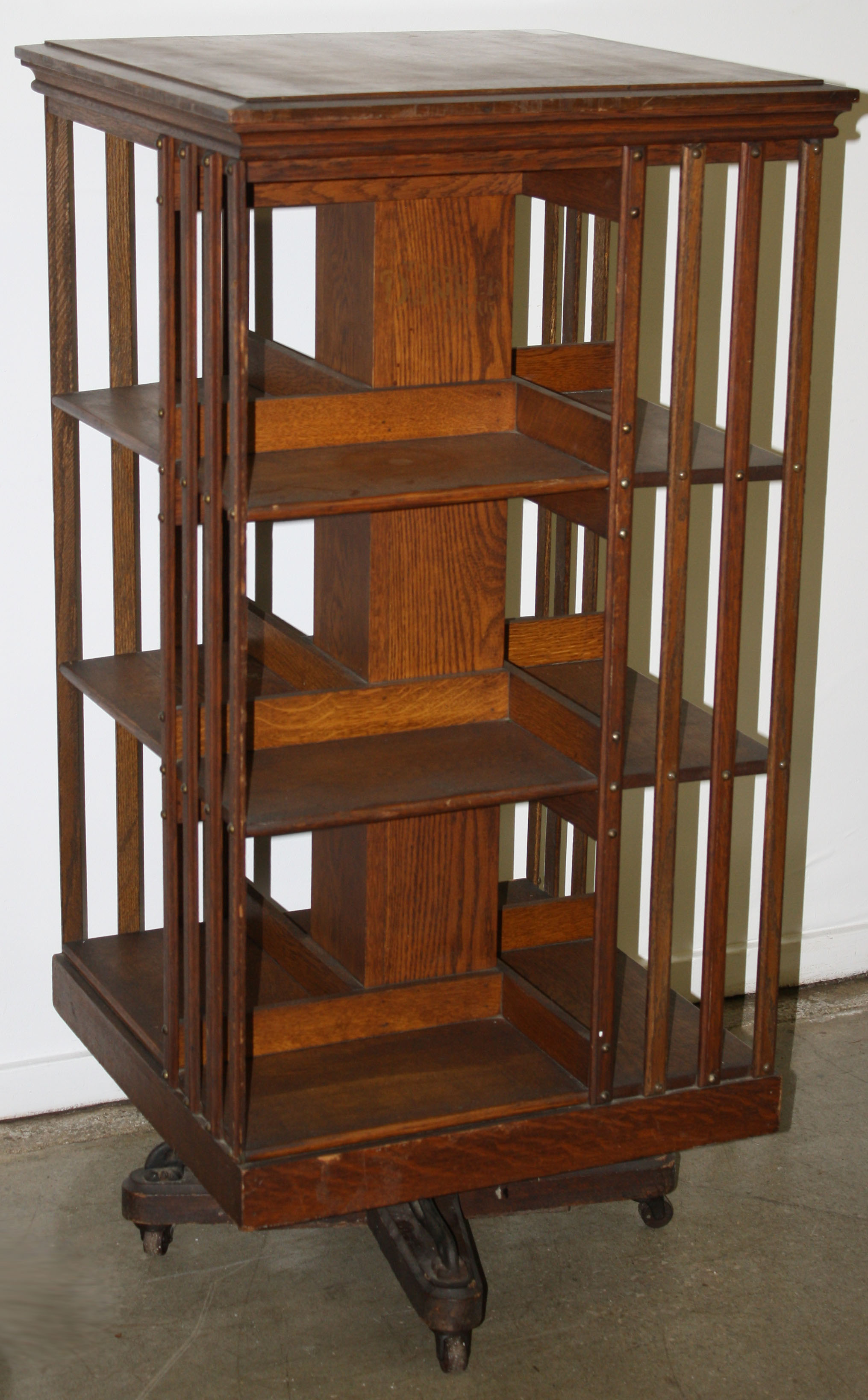 revolving chair with net co lift accident oak bookcase jpg merrill 39s auction