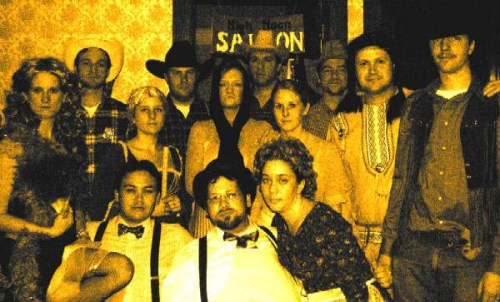 A group photo from Lindsey's Murder On The Prairie party