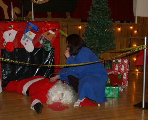 A photo of the victim at Who Killed Santa party