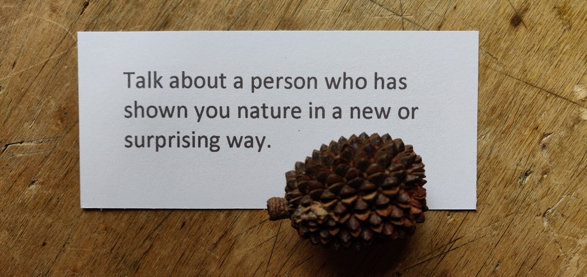 A card says 'Talk about a person who has shown you nature in a new or surprising way.'