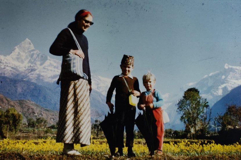 Mother and two children in front of Machapuchare, Nepal
