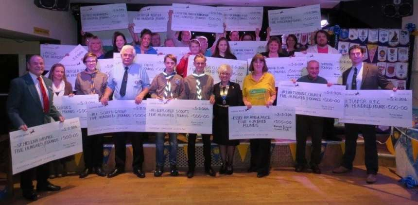 Representatives of organisations receiving donations from the Mersea Island Lions Club at their Presentation Evening at Waldegraves Holiday Park in February 2016 - photo Colin Kimble