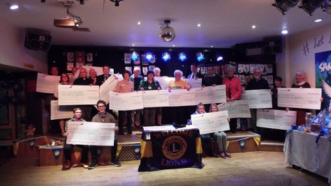 Representatives of organisations receiving donations from the Mersea Island Lions Club at their Presentation Evening at Waldegraves Holiday Park in February 2016 – photo Keith Bird