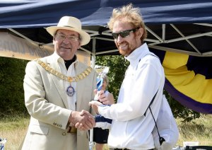 Mayor Peter Clements, MBE, presents the Winner's Cup to Thomas Payn, winner of the 10 Mile Race. Photo courtesy of Terry Turner