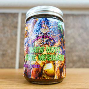 Dats Hott jar of jerk marinade sitting on the wood counter
