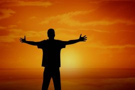Man rejoicing at the sunset