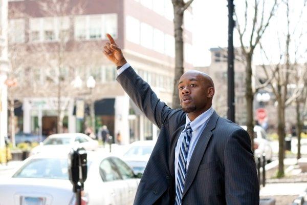 Hailing a taxi while black