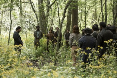 From left, Newt (Matthew McConaughey), Moses (Mahershala Ali), Rachel (Gugu Mbatha-Raw), Will (Sean Bridgers), Jasper (Christopher Berry) and other members of the Knight Company camp assembled in the woods