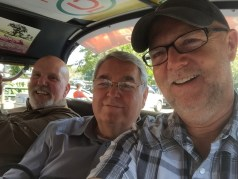 With Jim Randall and Ron Bouvier, riding in a Tuk Tuk in Thailand