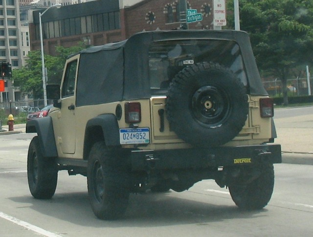 Manufacturer Plate?  Long Wheelbase?  Black wheels?  Windowless roof?