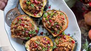 Stuffed Acorn Squash with Quinoa, Pomegranates and Walnuts