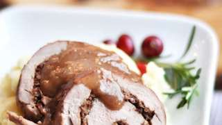 Cranberry Walnut Bacon Stuffed Pork Roll with Brandy Sauce