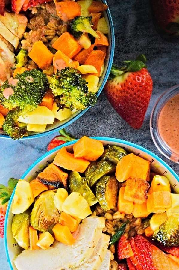 Lunch for 2, two big filled to the rim strawberry chicken grain bowls ready to serve
