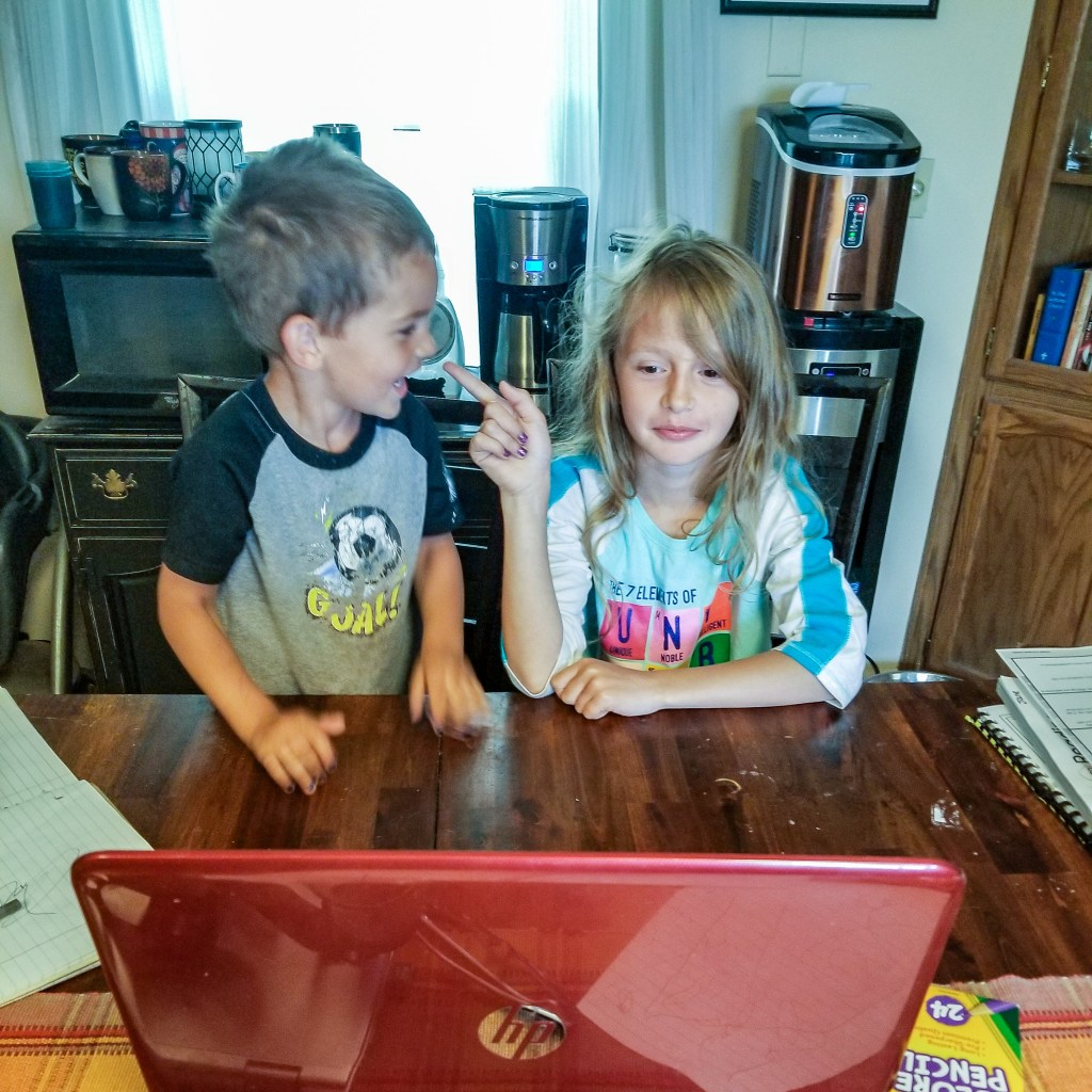 Jane and Eli arguing during remote learning during class.