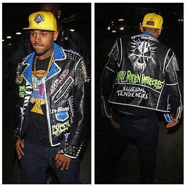 When not turning his wife's face into minced meat, Chris Brown can be found be trve kvlt.