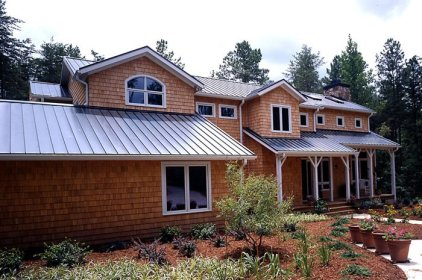 Many people like the look of shake on their roof, which Metal Roof Outlet offers, but when your siding is already shake you may opt for steel sheet as this family did.