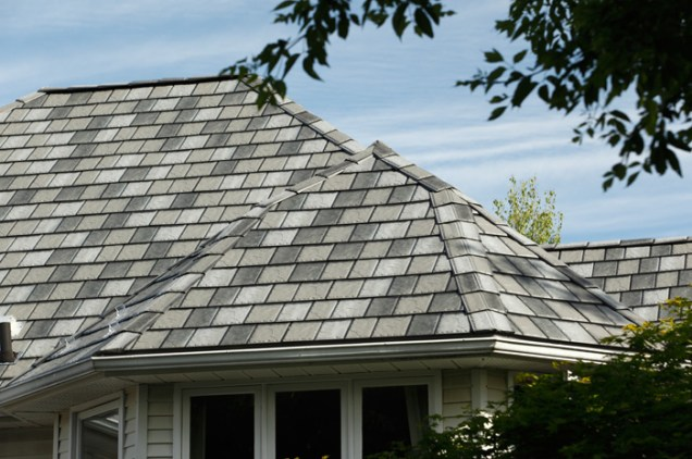 Metal Roof Outlet can offer slate-style metal roofs in a variety of colours - you can even get a mix of shades in one roof like this Ontario home.