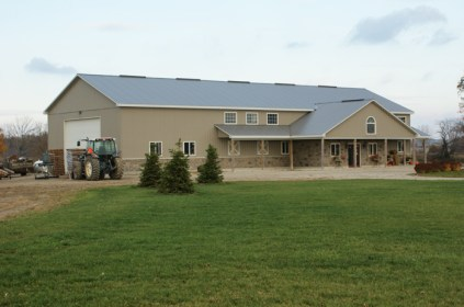 This lovely Ontario farmhouse is protected with a grey steel sheet roof from Metal Roof Outlet, Ontario.