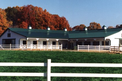 This beautiful classic stable is finished with a green steel sheet roof from Metal Roof Outlet.