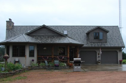 A one-story home with installed steel shake roofing by Metal Roof Outlet
