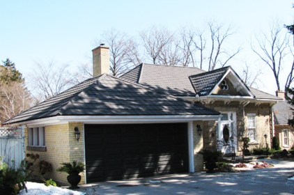 Metal slate style roof from Metal Roof Outlet on a yellow brick cottage