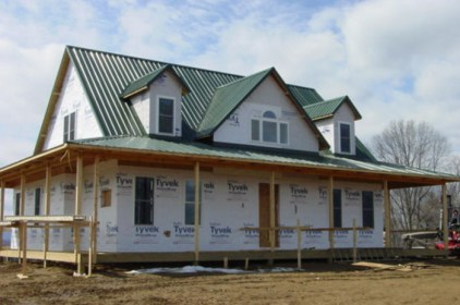 It's a work in progress, but the steel sheet roof on this Ontario home is a sign of beautiful things to come!