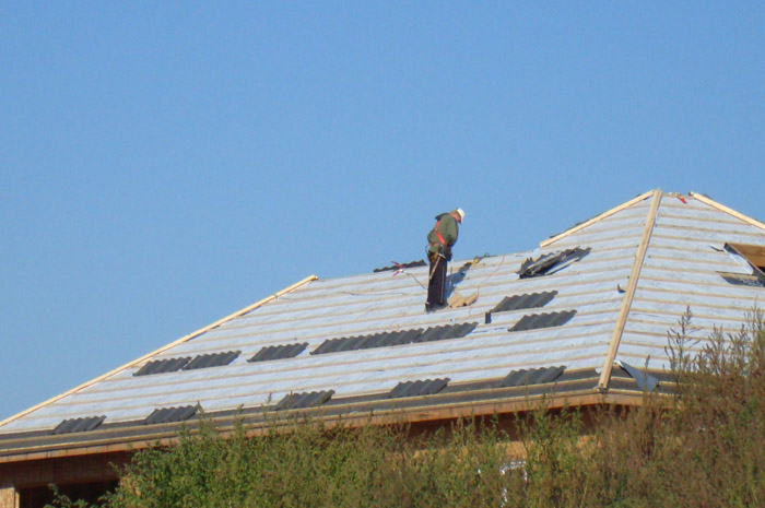 Here you can see one of Metal Roof Outlet's dedicated installation experts working on an Ontario home.