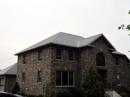 A home with a Steel Wakefield Bridge Shingle roof by Metal Roof Outlet