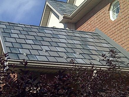 Metal roofs can mimic almost any material or finish you prefer - including a traditional slate-style roof as seen on this Ontario home.