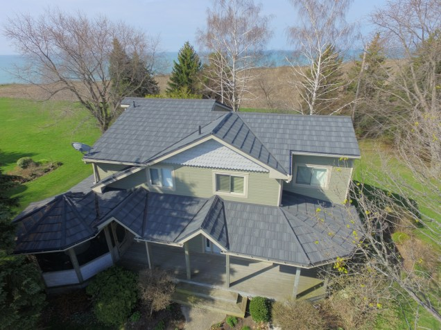 A lakeside home in Port Rowan with a Weathered Wood steel shake roof