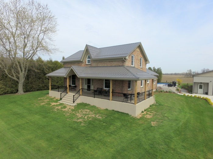 A two story Port Stanley Ontario home with metal slate roofing from Metal Roof Outlet