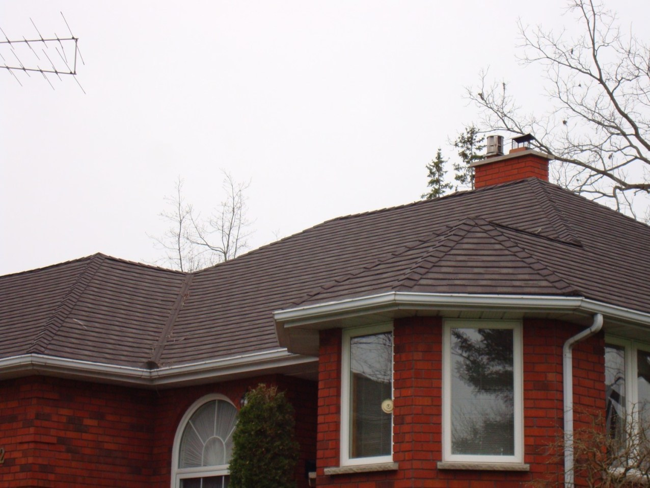 Timberwood coloured Granite Ridge metal shingle roof installed by Metal Roof Outlet