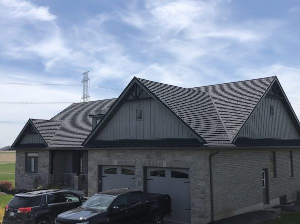 An installed Charcoal CF Shingle roof from Metal Roof Outlet