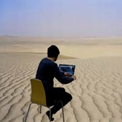 img man learening alone in desert