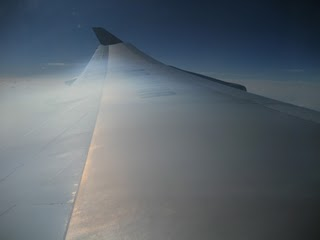Shock wave refraction and iridescence over airplane wing (2/5)